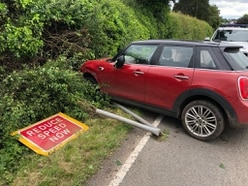 Suspected drink driver crashes Mini into 'slow down' sign