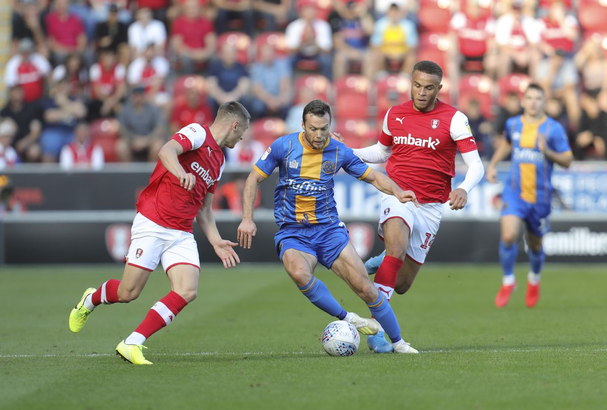 Shaun Whalley of Shrewsbury Town and Ben Wiles and Carlton Morris of Rotherham United (AMA)