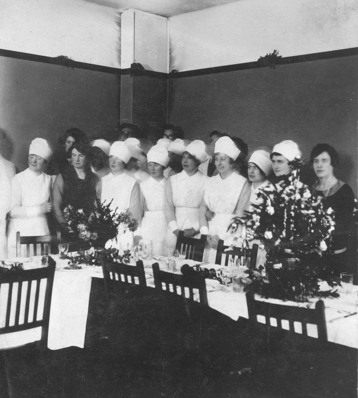 """These are nurses at a hospital in Shropshire in the 1920s, although we're not sure where exactly. Fourth from right is Miss Gladys Deacy, whose niece Della Bailey originally loaned this picture. Nurse Deacy lived at various times at Kemberton and the Catholic House in Madeley.The back of the picture says it is at """"Wantage House."""" Could that perhaps have been part of a hospital at Shifnal, Bridgnorth, or Shrewsbury?"""