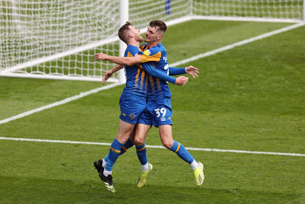 Josh Vela of Shrewsbury Town celebrates after scoring a goal to make it 2-1 with Tom Bloxham. (AMA)