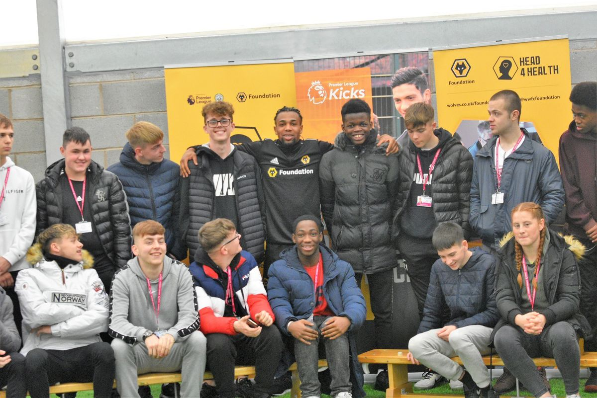 Adama Traore with students from Telford College