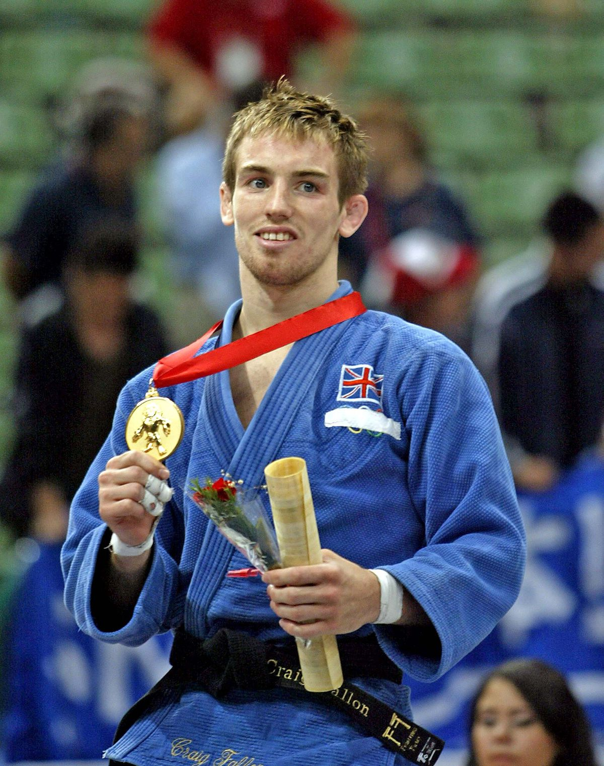 Craig Fallon celebrates after defeating Austria's Ludwig Paischer to win a gold medal during the World Judo Championships in Cairo, September 11, 2005