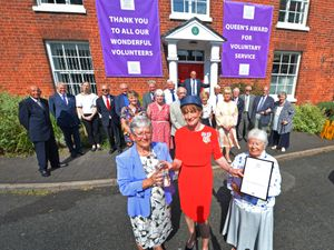 Presenting the Queens Award for Voluntary Service to The Red House, is Shropshire Lord Lieutenant Anna Turner, with, management trustees Val Kirton, left and Rita Hester