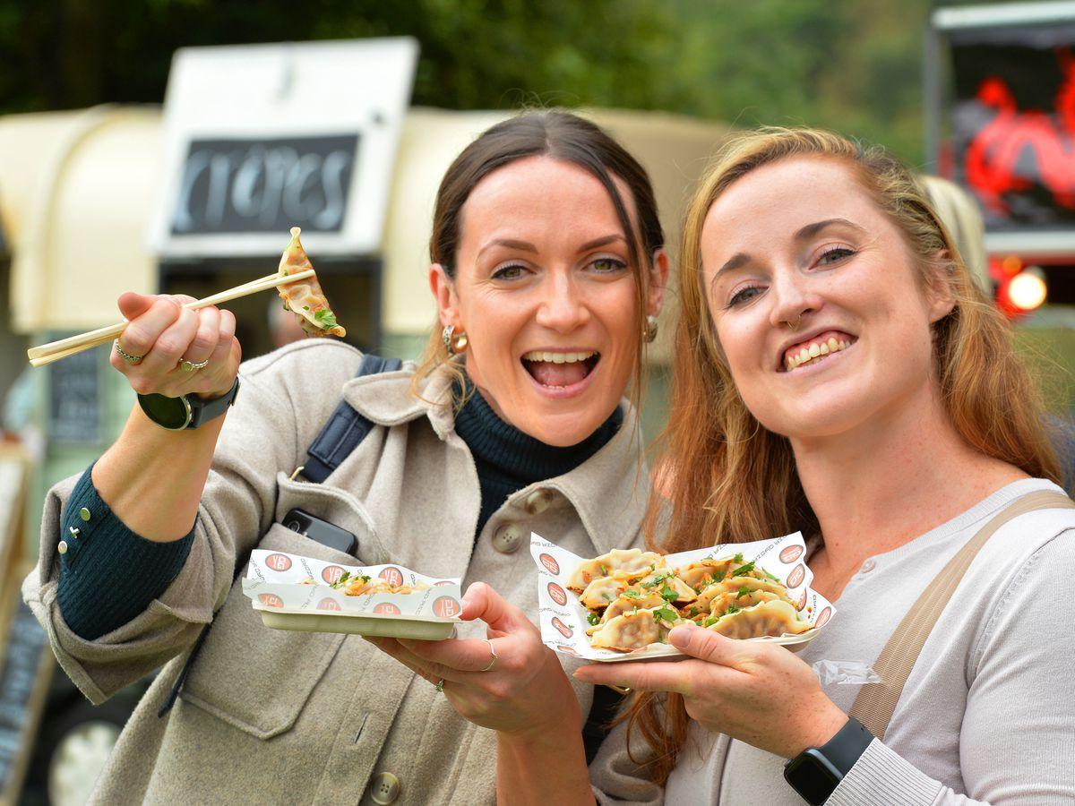 Enjoying Japanese street food, (left-right) Tash McEntagart and Amy Brownridge, both of Telford, during Shrewsbury Food Festival