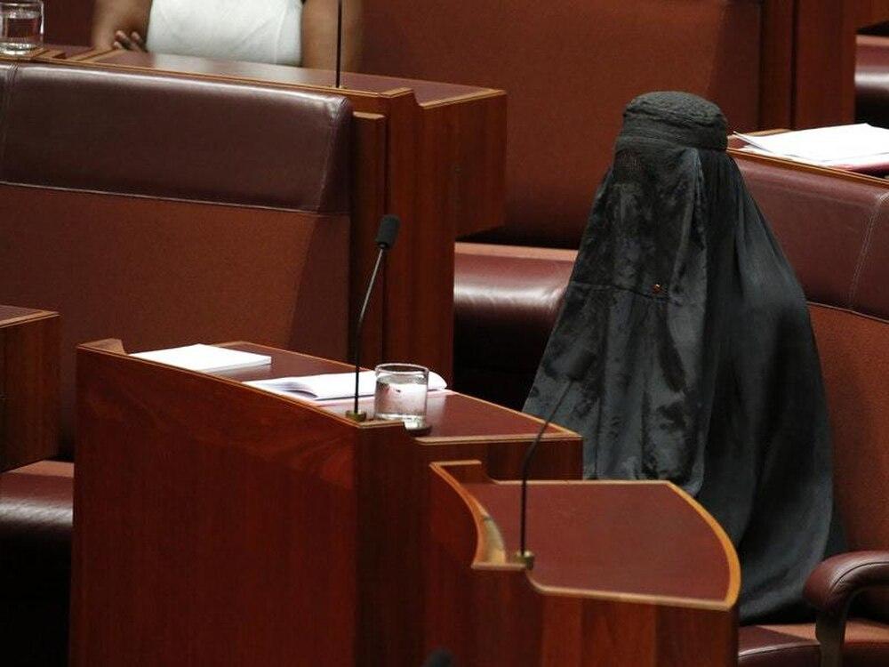 Pauline Hanson wears burqa in Australian Senate while calling for ban