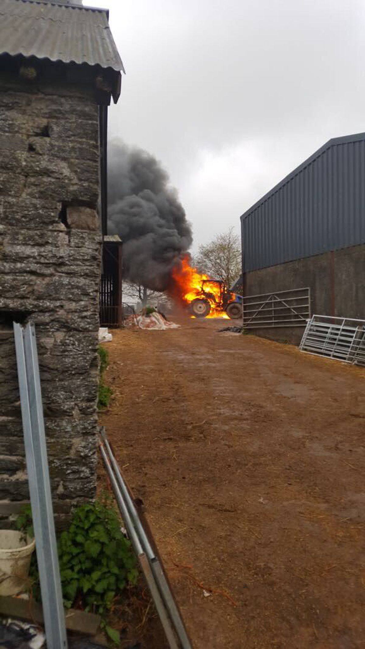 A tractor went up in flames at a Newcastle farm. Pic: @SFRS_Clun