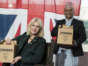 Actress Joanna Lumley with Sujan Katuwal, the owner of Nepalese restaurant Panas Gurkha in Lewisham