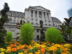 Bank keeps rates on hold and cuts second quarter growth outlook