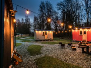 'The Hamlet' at Samlesbury Hall features groups of three colourful shepherd's huts