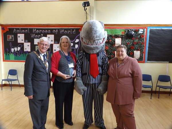 Just Credit Union Chief Officer Karen Farrow and a loan shark flanked by Councillor Stephen Reynolds and Councillor Jackie Loveridge at a school awareness event which has subsequently resulted in national recognition