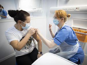 Nurse administers a coronavirus vaccine