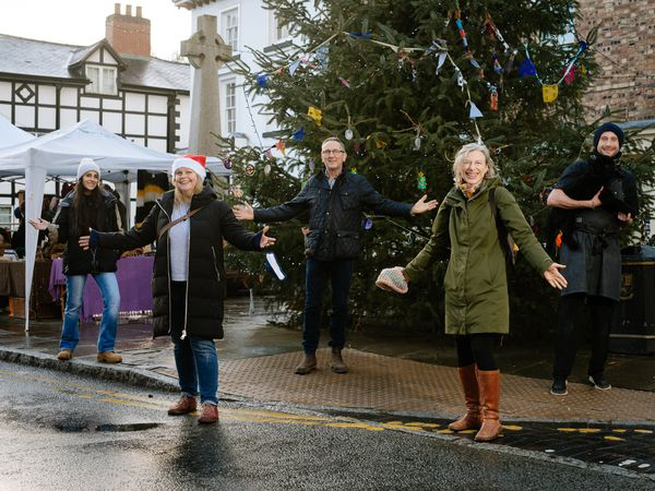 Llanfyllin's Christmas Market is back. Pictured from left, Councillors Sophie Nazar, Jane Carrington, Mayor Peter Lewis, Alison Alexander and Julian Raymond-Sandy