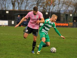 Jason Oswell of Telford battles for the ball with Chris Atkinson