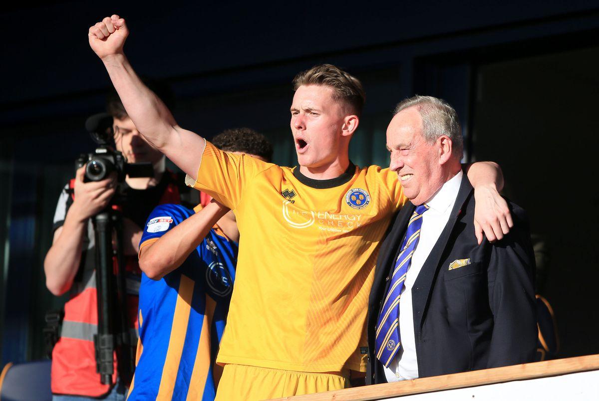 Shrewsbury Town goalkeeper Dean Henderson celebrates with Shrewsbury Town Chairman Roland Wycherley