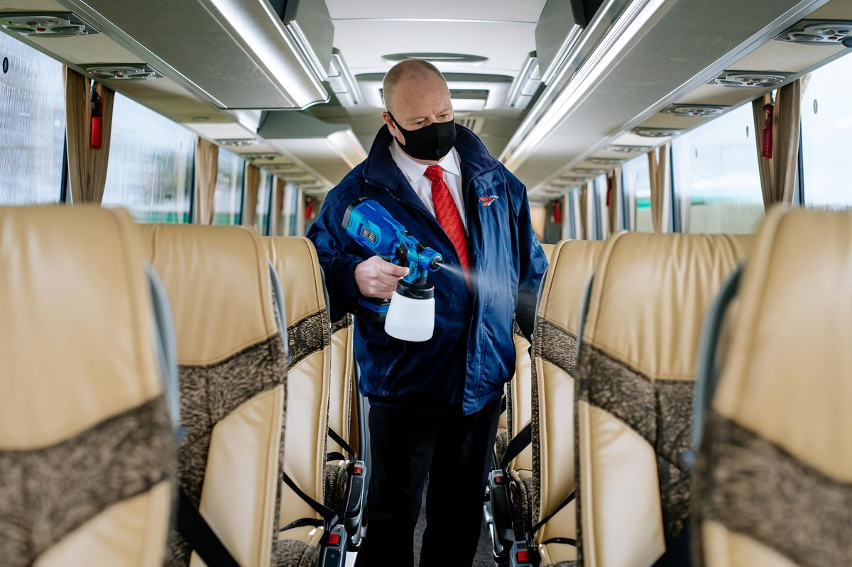 Tour Driver Andy Evans cleaning the coaches