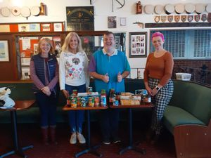 Alex Ash, with staff at Newport's food bank