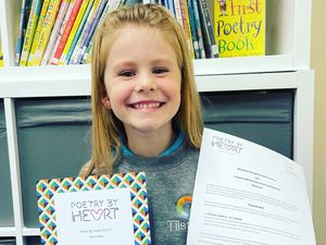 Lyla Rolfe, six, with her certificate
