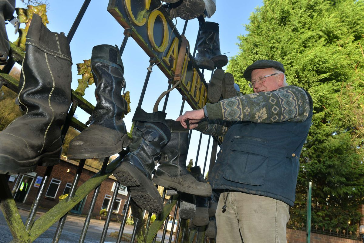 Graham Hickman hangs a pair of boots on the gates