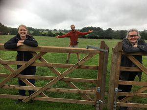 Farm youth workers, from left, Caroline Rose, Mike Grabarz and Wendy Murray