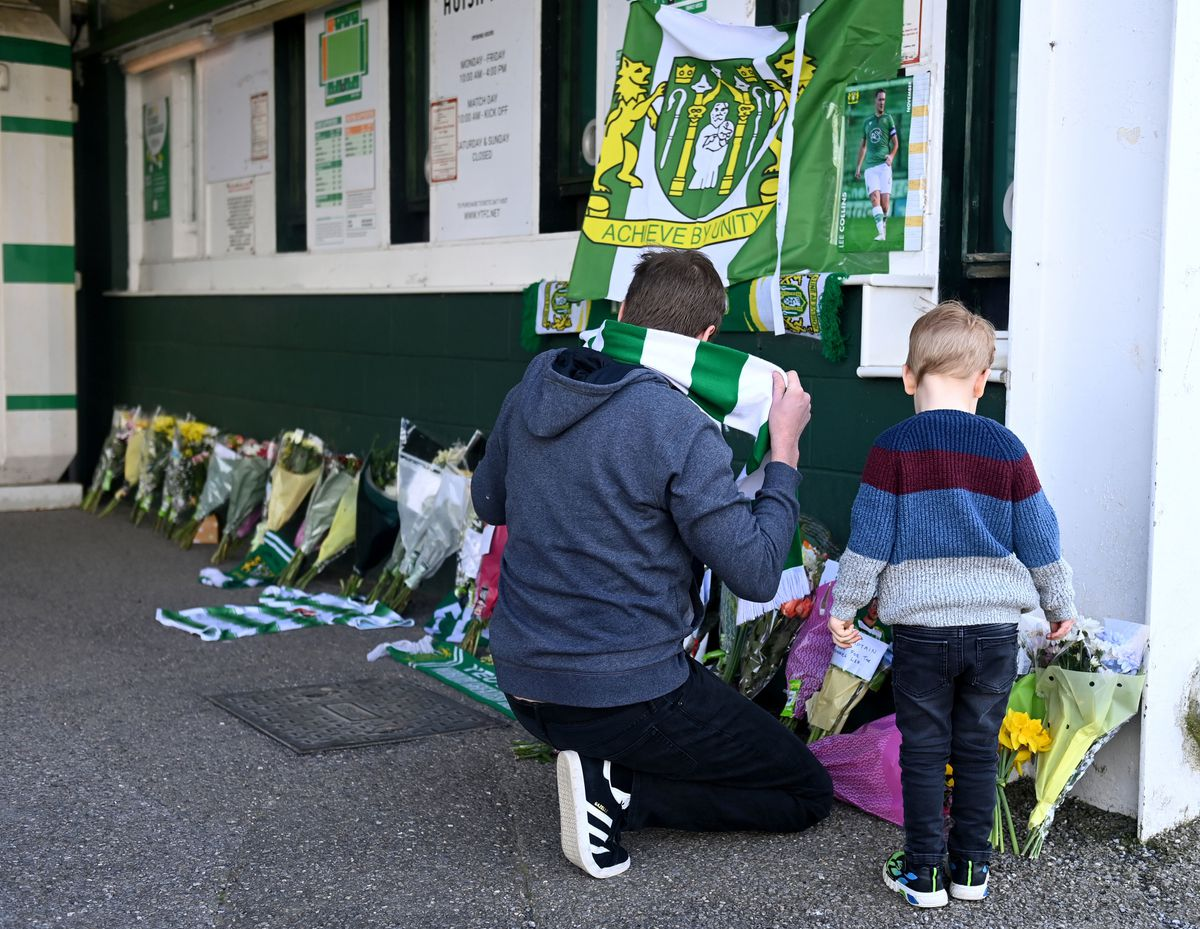 Tributes are laid outside Huish Park in memory of captain Lee Collins who died aged 32 on Thursday April 1, 2021.