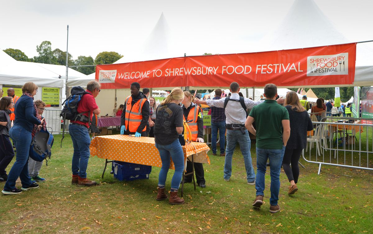 People enter Shrewsbury Food Festival, at The Quarry