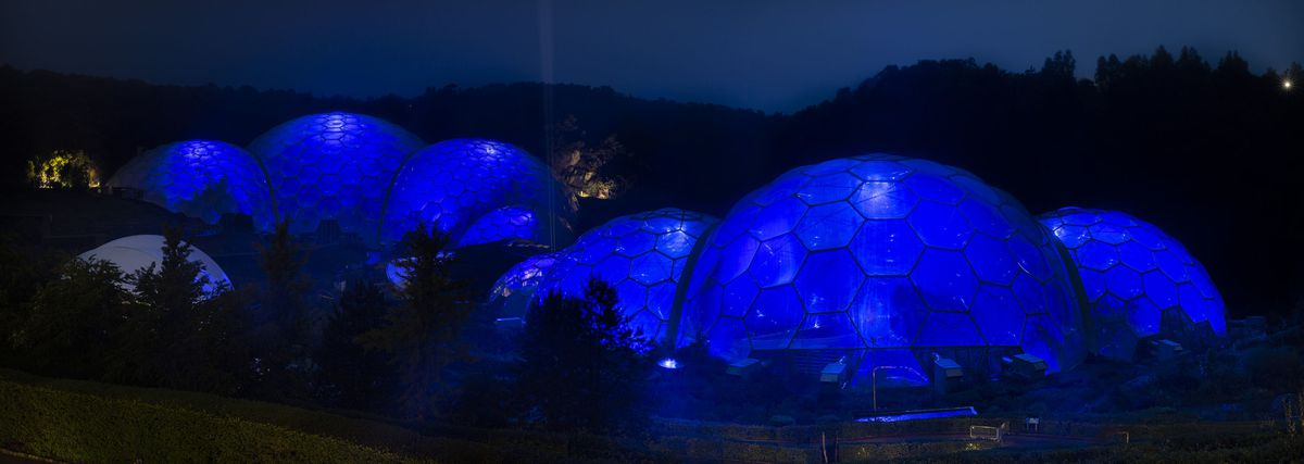 The Eden Project Biomes illuminated blue on Friday evening as part of the NHS birthday celebrations. PA Photo