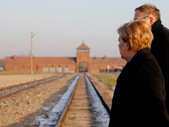 Angela Merkel visits Auschwitz and says crimes must never be forgotten