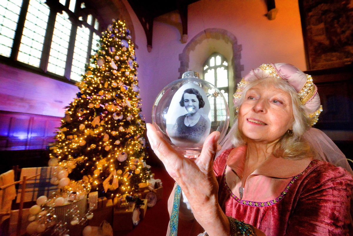 "Marianne Harries with the Servants' Tree in the Chapel, with a picture of ""Jean"" who was a laundry maid on the domestic staff of yesteryear."