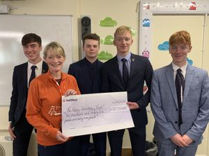 OsBiz pupils presented the cheque to Sally Johnson