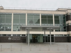Woman admits robbing blind man as he walked through Wrexham with his white stick