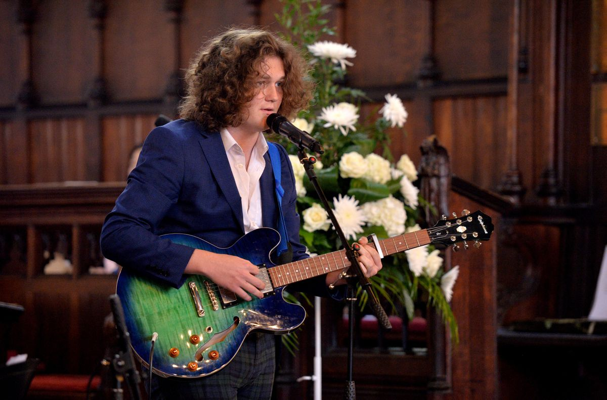 Daniel Morris performs during the service