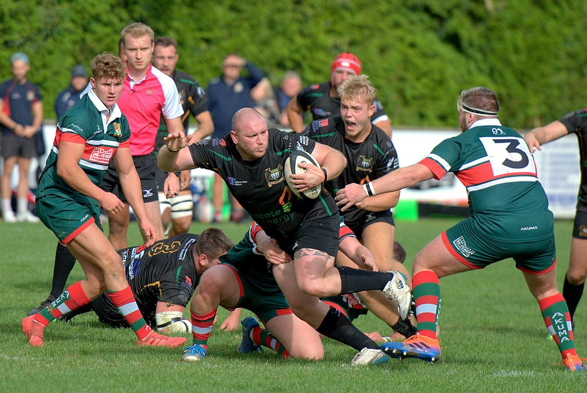 Try-scorer Conor Nicholls holds on to the ball while his Bridgnorth team-mates celebrate     Pictures: Dave Cooper