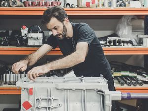 Technician Brett Egger with the repaired block