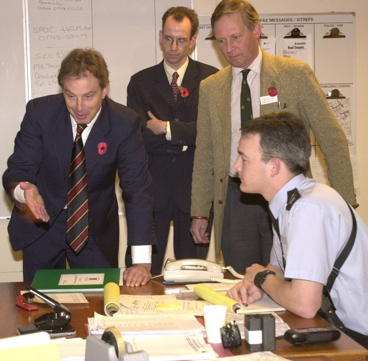 The millennium floods were deemed so bad that Prime Minister Tony Blair visited the county. Here he chats to PC David Meyer in the emergency planning room at the Shirehall with emergency planning officer Ian Sawers, top right and MP at the time Paul Marsden
