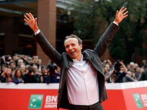 Roberto Benigni poses for photographers as he arrives on the red carpet at the Rome Film Festival (Gregorio Borgia/AP)
