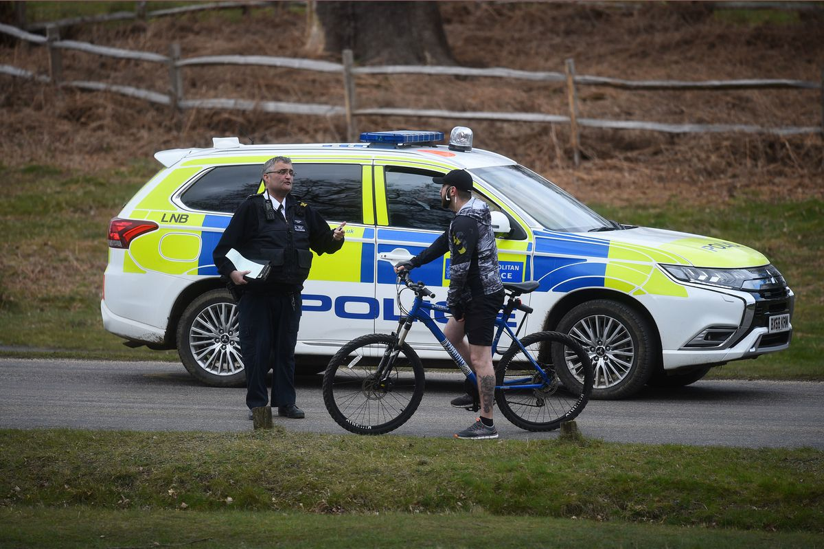 Police patrol stops to speak to a cyclist