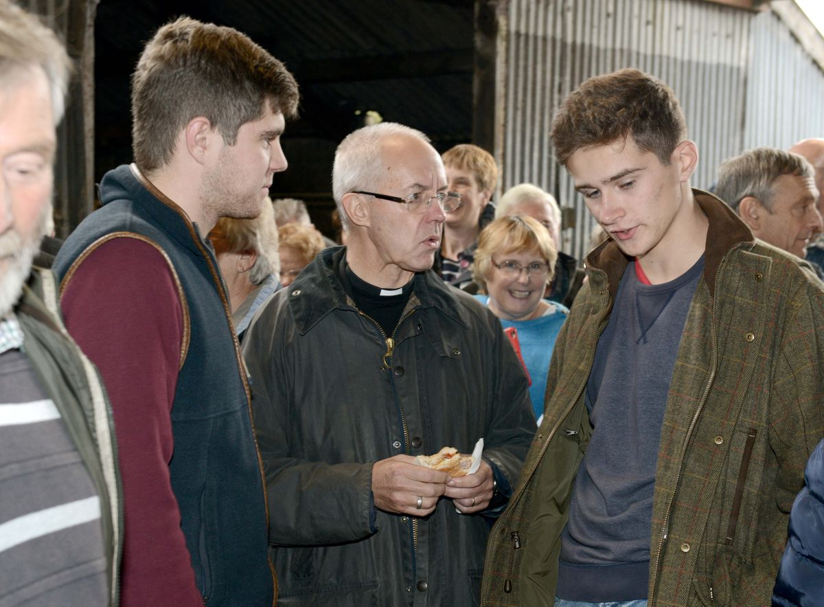 The Archbishop of Canterbury talks to Ed and Will Norris at Oakwood Farm in Longville, Much Wenlock