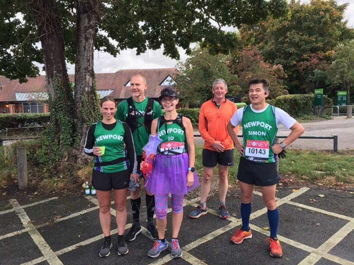 Joanne Lutner, centre, was among the Newport runners to carry out their own virtual marathons around the town and they were supported in parts by other members