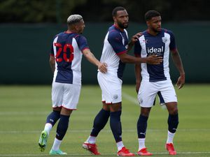Matt Phillips of West Bromwich Albion celebrates after scoring a goal to make it 1-0 with Karlan Grant of West Bromwich Albion and Darnell Furlong of West Bromwich Albion.