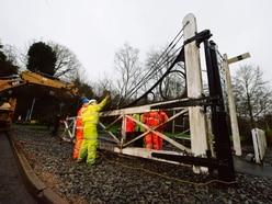 Historic Ironbridge railway crossing gates being restored