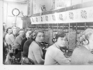Switchboard operators at Shrewsbury telephone exchange – believed to be in 1953. From right: Mrs Stanley, four unidentified, Alma Wigley, Elaine Thomas, and Marjorie Chidley. Standing behind the women is engineer in charge Vernon Jarvis.