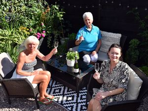 Vanessa Steadman celebrating her win with judge, Maggie Love and Balfours, Abigail Barker who organised the Annual English Garden competition.