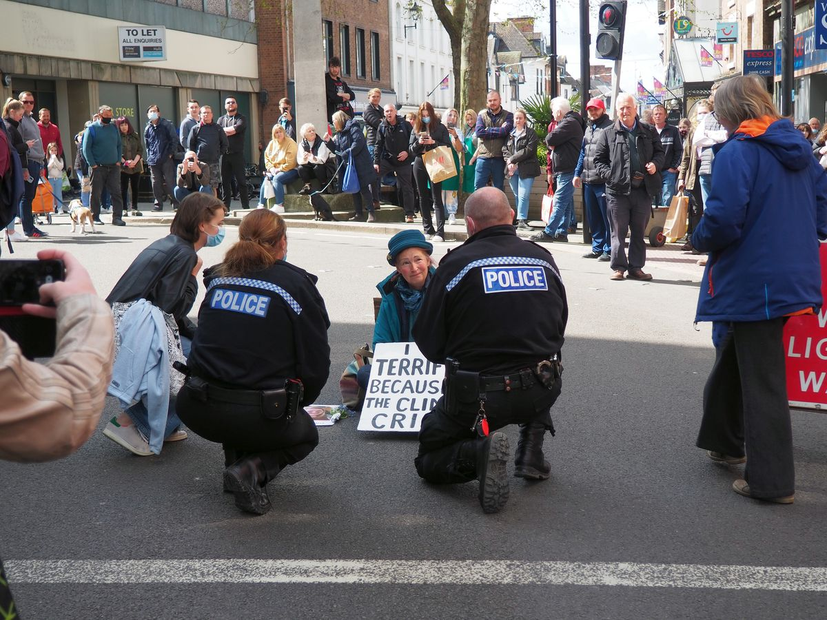 The protester being spoken to by police. Photo: Phil B