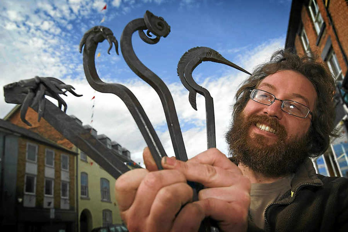 Rowan Taylor, from Ellesmere Canal Forge, brandishes some of his fire pokers at the Welshpool craft fair