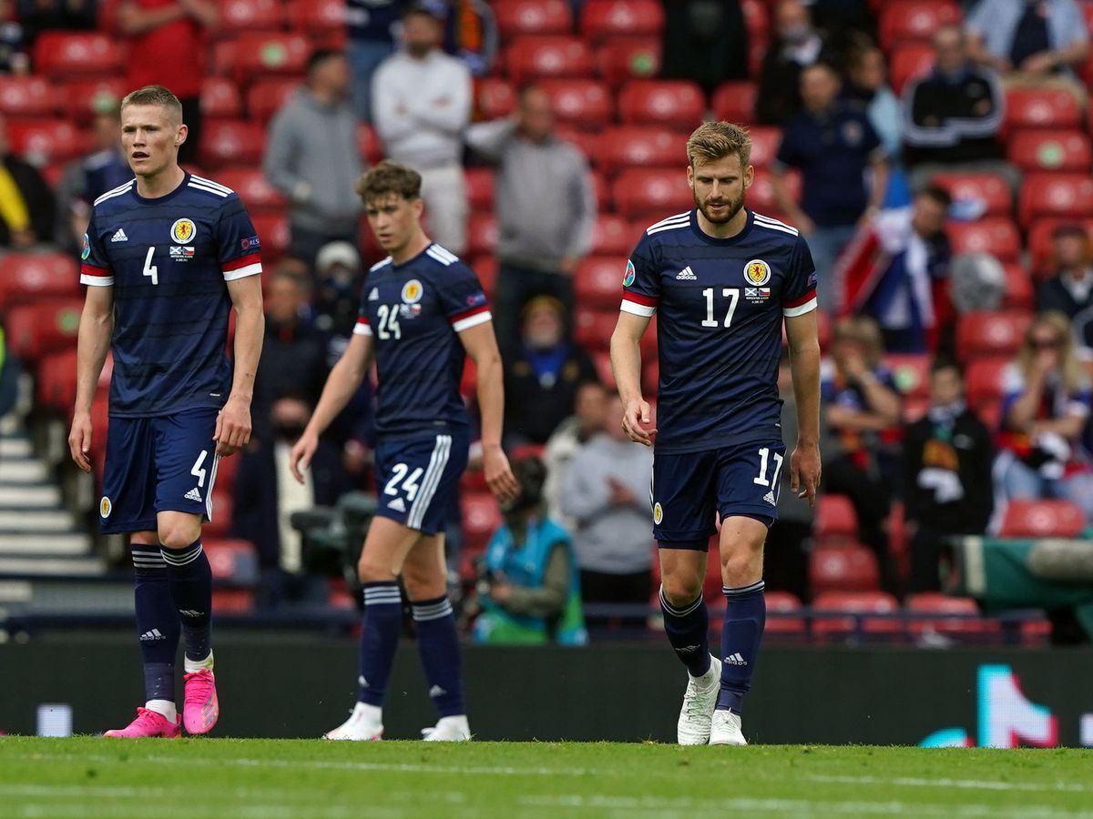 Scotland's Scott McTominay, Jack Hendry and Stuart Armstrong stand dejected