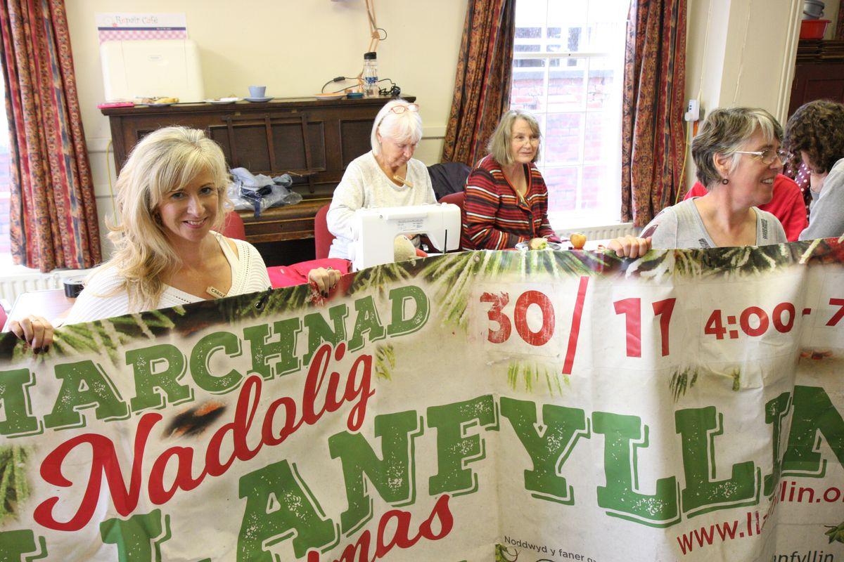 Volunteers use sewing skills to repair Llanfyllin's Christmas banner