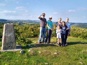 Walkers enjoy the sun at the top of Trefonen Hill
