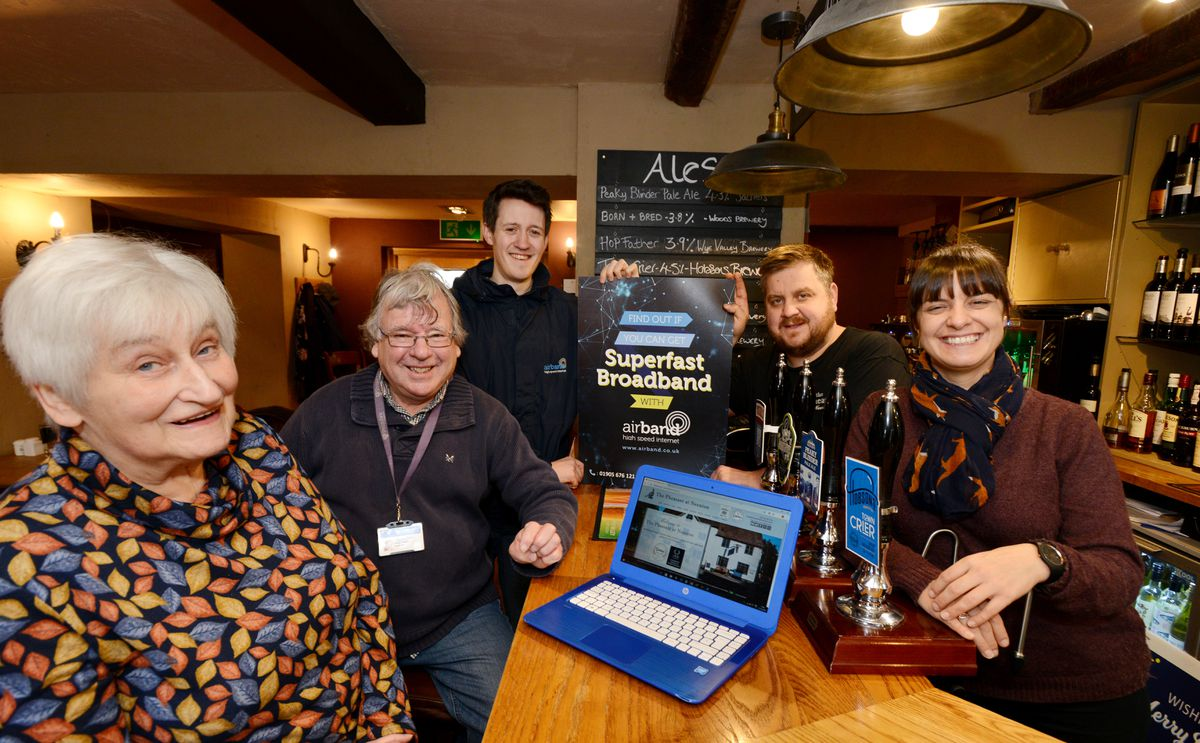 Airband's Shropshire Community Ambassador Andy Chaloner (centre) with Pheasant Manager and Head Chef Mark Harris (second right),  Manager Front of House Sarah Cowley (right), Parish Clerk Bobby Jarvis (left) and Cllr Robert Tindall, at The Pheasant, Neenton. Photo: Chas Breton