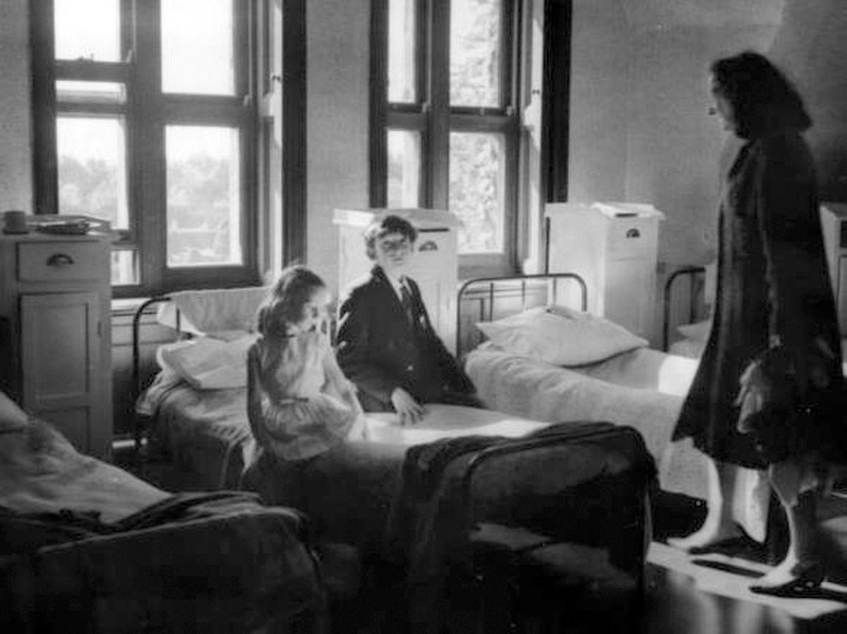 Michael, his mother, and his sister Katy in his dormitory at Cheswardine Hall.