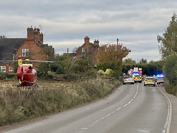 Emergency services at the scene of a crash involving a car and motorcycle on Eccleshall Road, Forton. Photo: Simon Tebb